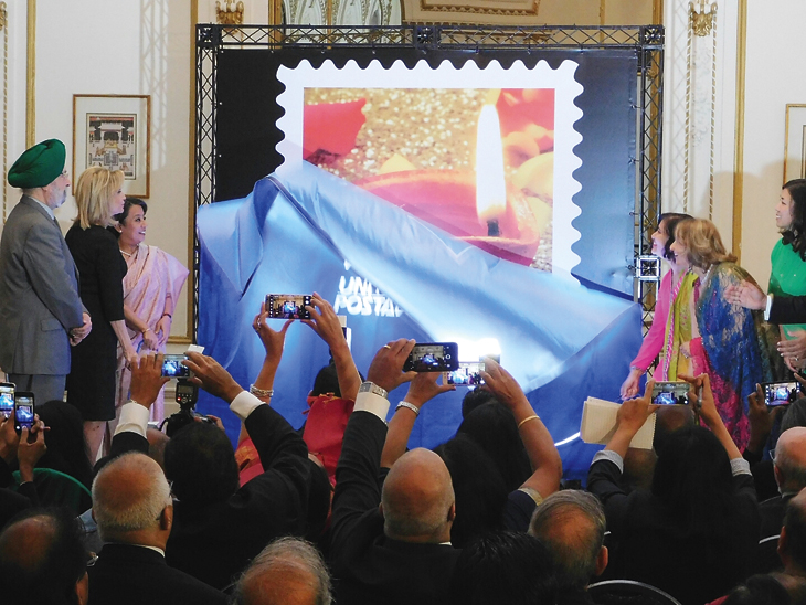 ceremony-participants-unveil-the-design-of-the-diwali-forever-stamp