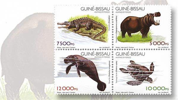 guinea-bissau-se-tenant-block-of-fou-endangered-animals-stamps