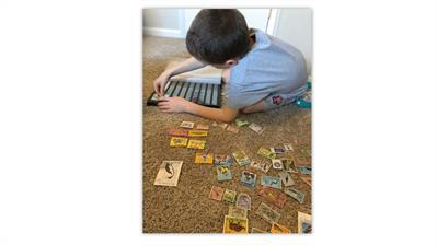 jay-bigalke-oldest-son-collecting-stamps