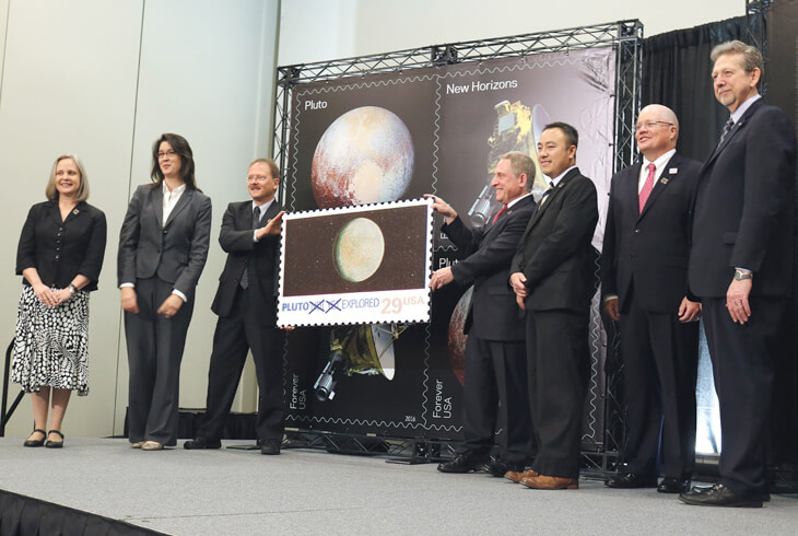 pluto-explored-views-of-our-planets-stamps-unveiling