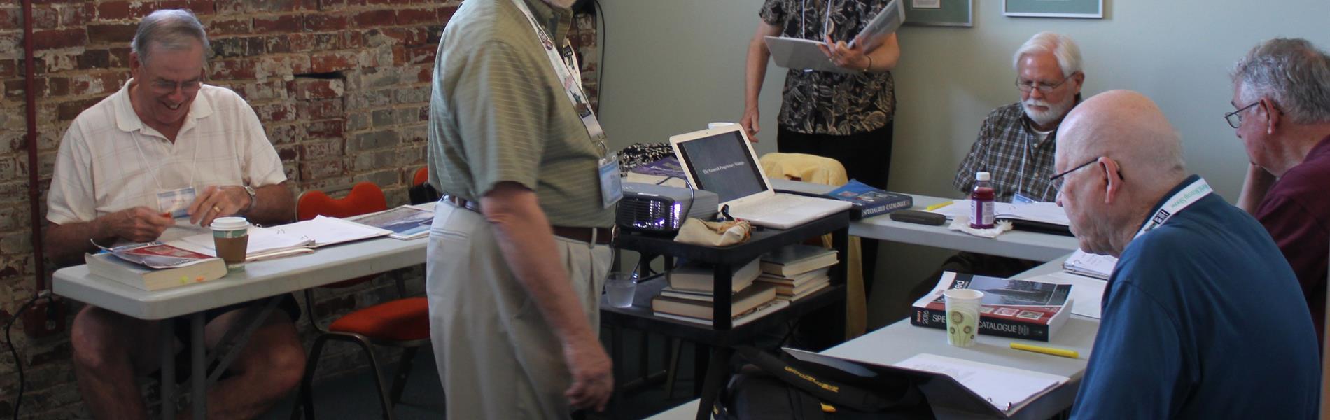 revenue-stamp-expert-ron-lesher-addresses-seminar-participants